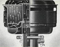 Efficient, oil-bath-type air cleaner on International Green Diamond engines, showing the new and exclusive type of dust-proof seal with rubber gasket in the connection between the air cleaner and carburetor.