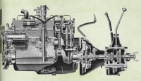 In this sectional view of the powerful new Model K-5 Green Diamond engine, clutch and transmission many important features are shown to advantage. The heavy counterbalanced crankshaft; rubber-insulated torsional vibration damper; long-skirted pistons with four rings; full-floating piston pins; rifle-drilled connecting rods; floating-type oil intake; 10-inch clutch; and heavy-duty, 4-speed transmission are clearly shown.
