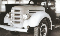 This archival photograph exhibits what appears to be another earlier design of the D-Series with a curved nose and fenders more enclosed than the C-Series. From the McCormick-International Harvester Collection at the Wisconsin Historical Society (Image ID #109956)